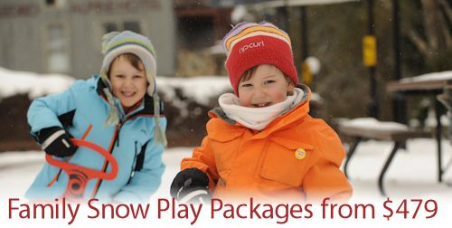 Children playing in the snow with toboggans. A special Snow Play Package offer