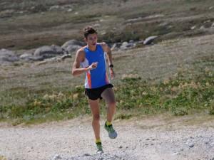 A runner strides up a mountain