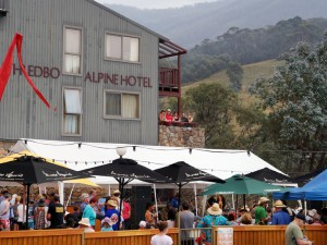 People congregating outside the Thredbo Alpine Hotel