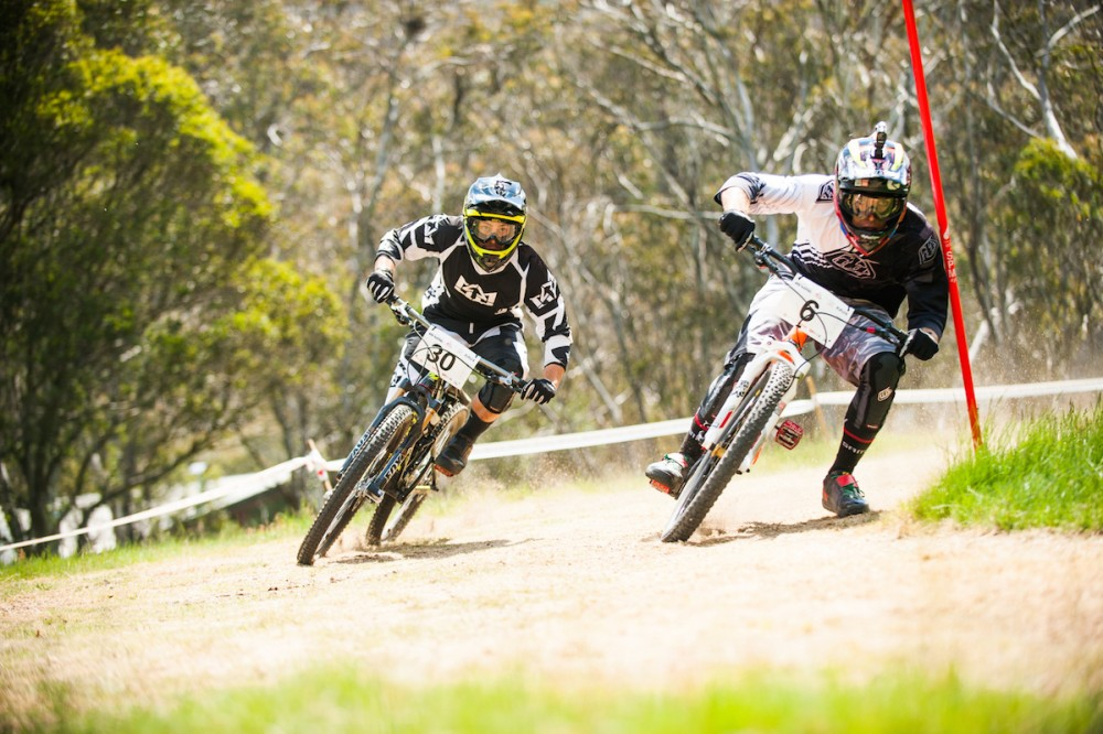 Flat turns are also a relic of mountain bike racing of the past. Here Graeme Mudd leans it in to get the holeshot and eventual win over Blake Nielson in the Dual Compressor final.