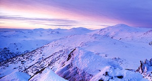 Snowy Mountains at sunset by Tim Wrate