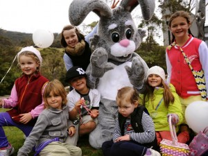 Kids with the Easter bunny enjoying their treats