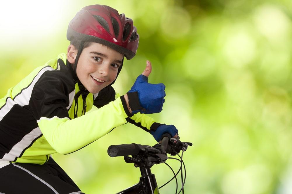 happy kid on his bike