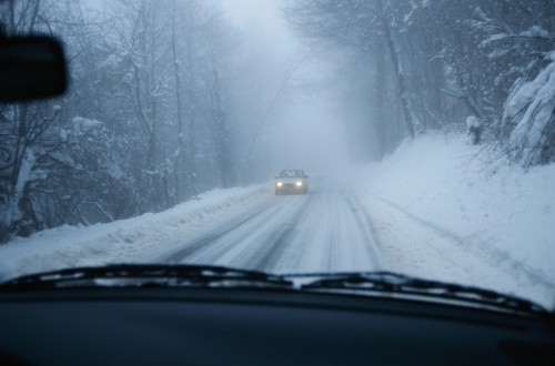 Car driving in snow, winter